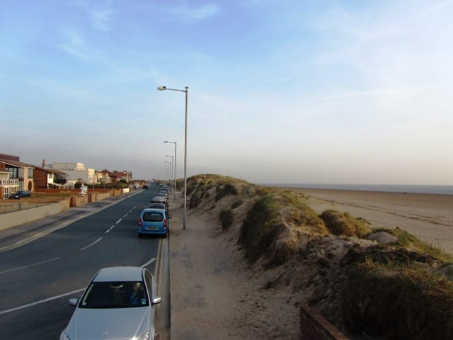 Parking against the Sand dunes of North Promenade on St Annes seafront and beach