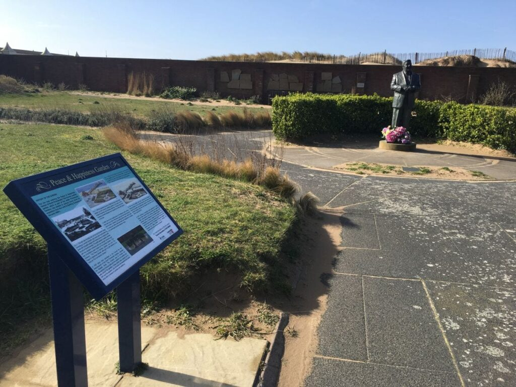 Peace and Happiness Garden against St Annes Pier